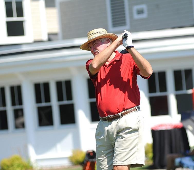 A golfer swings his club at the FEEDNH Charitable Golf Tournament