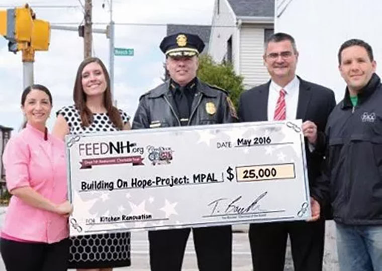 FEEDNH.org donates $25,000 to the Building On Hope project for the Manchester Police Athletic League. (L-R) Chef Nicole Barreira, Great NH Restaurants, Tanya Randolph, FEEDNH.org, Manchester Police Chief Nick Willard, Chief David Mara, and Police Officer John Levasseur.